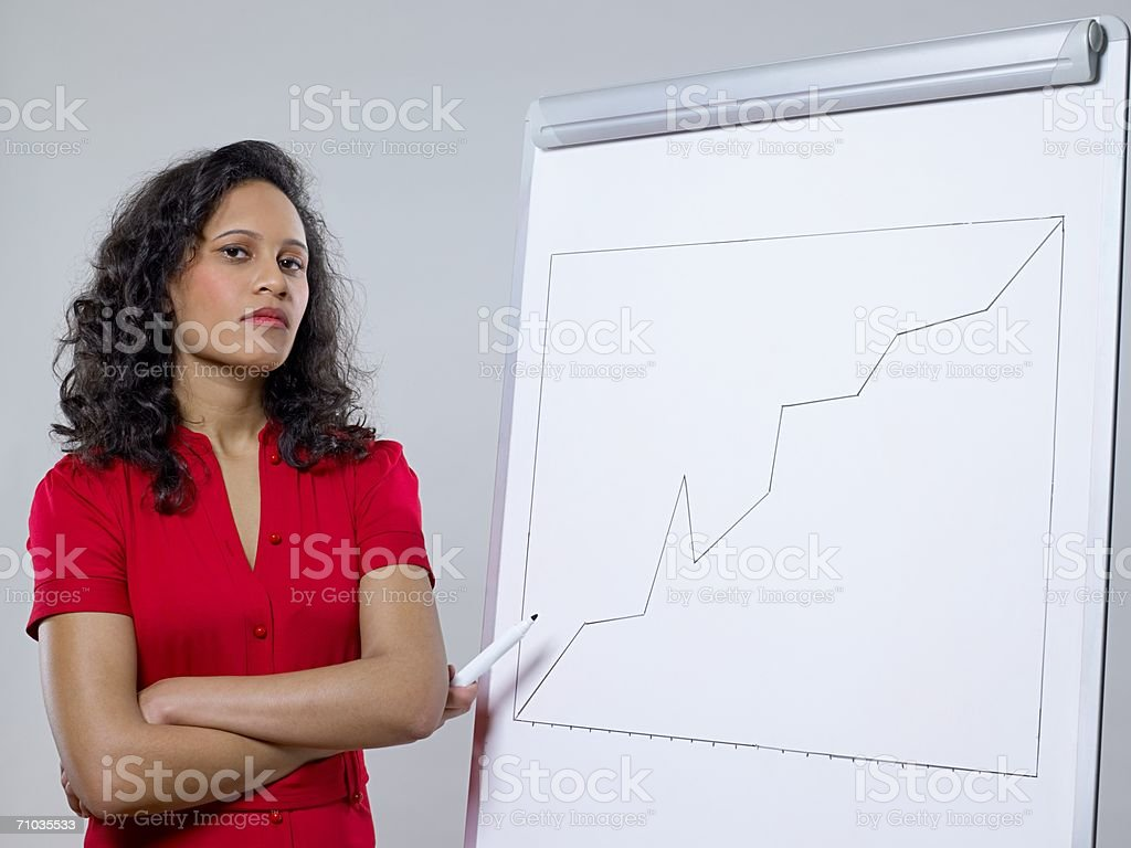 Woman with graph stock photo