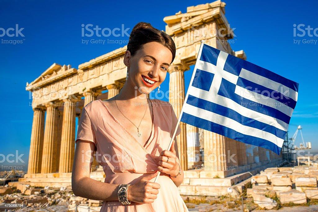 Woman with Greek flag on Parthenon background stock photo