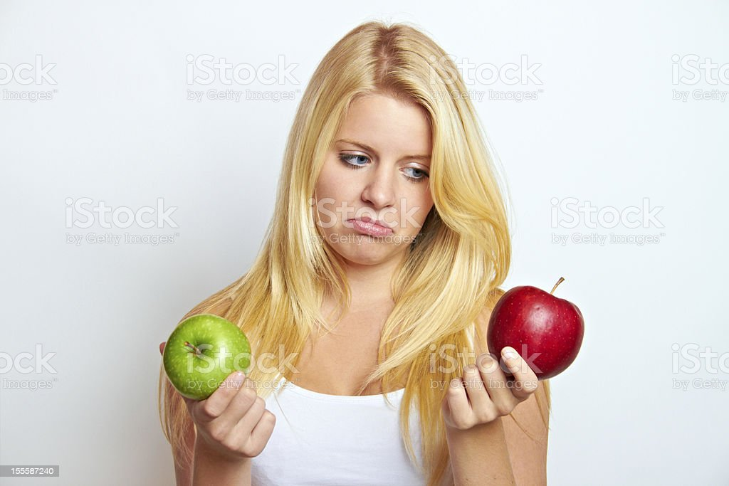 woman with green and red apple stock photo
