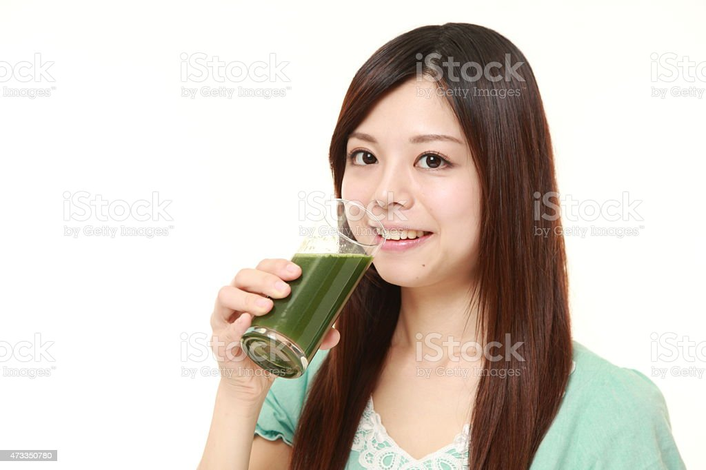 woman with green vegetable juice stock photo