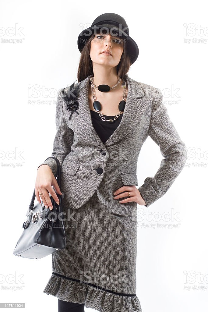 woman with grey dress and hat. stock photo