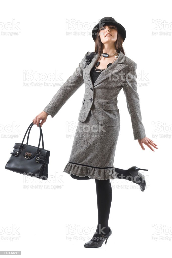 woman with grey dress and hat royalty-free stock photo