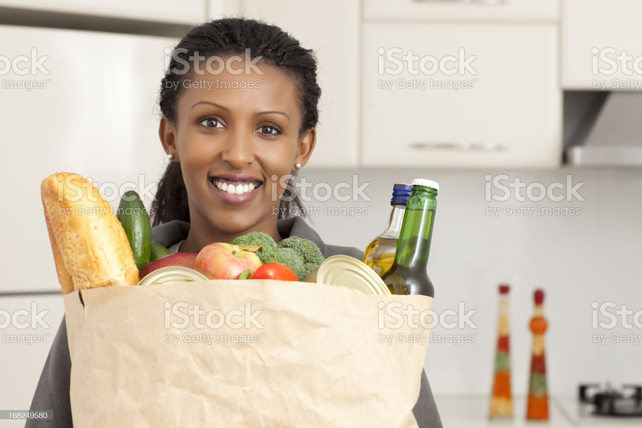 Woman with grocery products. royalty-free stock photo