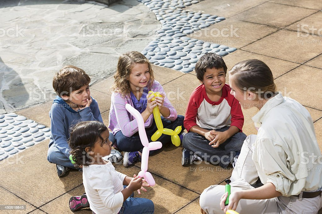 Woman with group of children stock photo