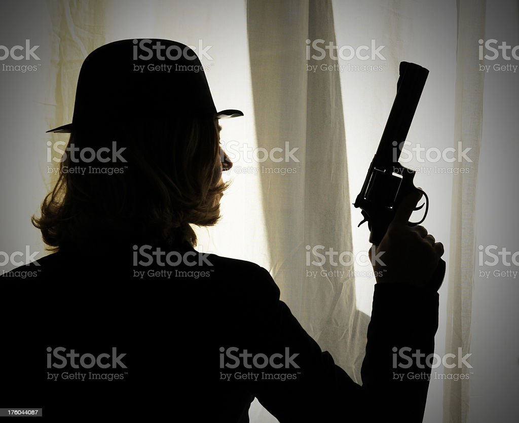 Woman With Gun Hiding royalty-free stock photo