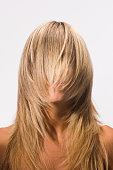 Woman with hair covering face