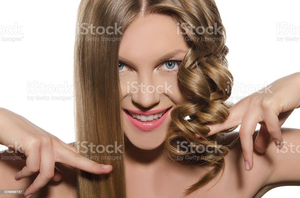 Woman with haircut keeps hair in hands stock photo