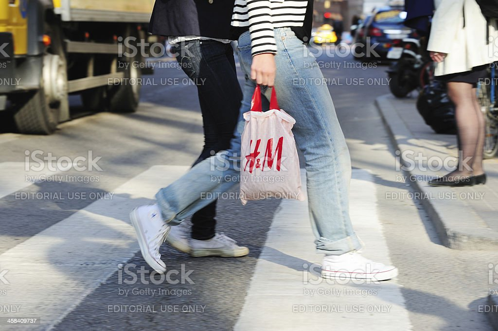 Woman with H&M bag stock photo