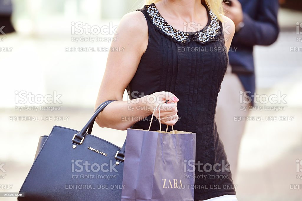 Woman with hand- and shopping bag stock photo