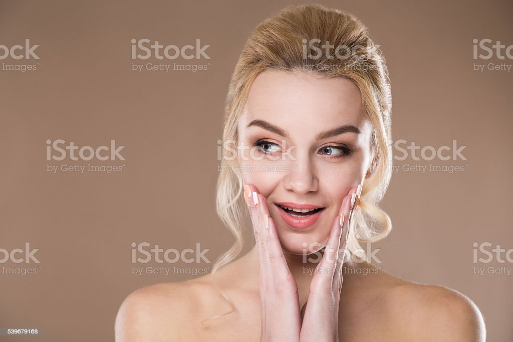 woman with hand near the face stock photo