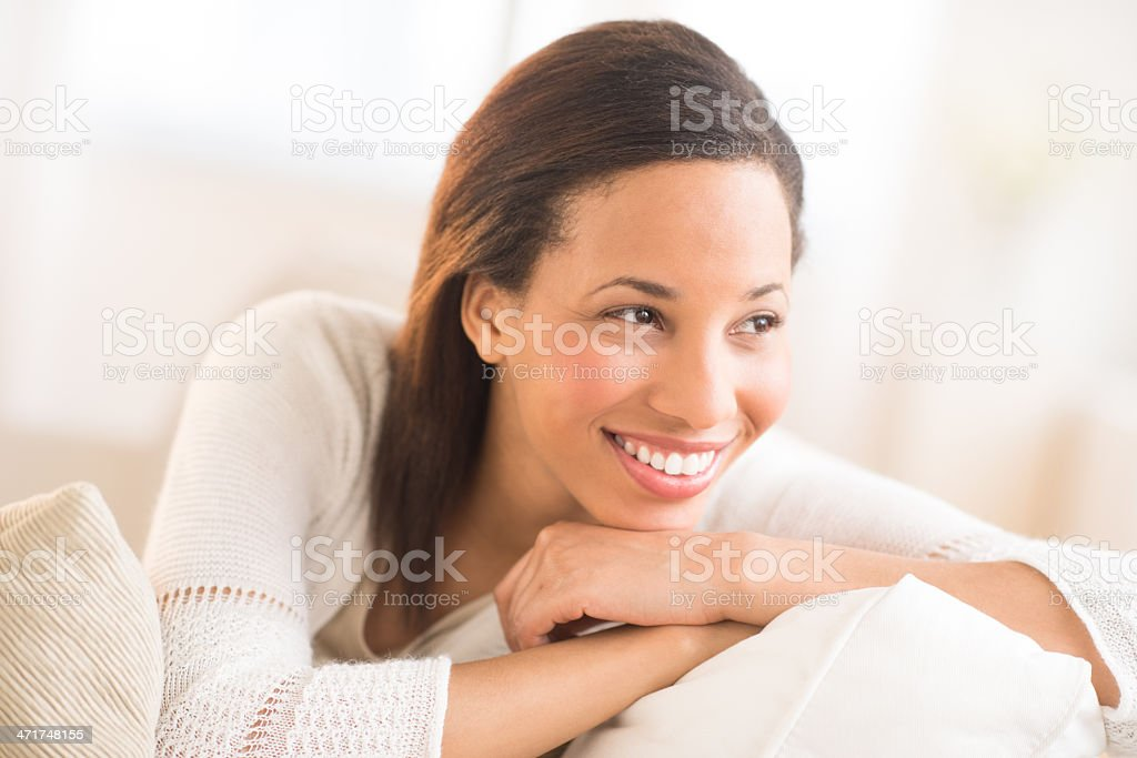 Woman With Hand On Chin Looking Away At Home royalty-free stock photo