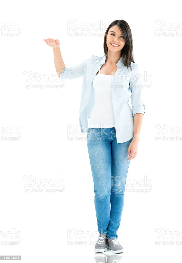 Woman with hand on imaginary object stock photo