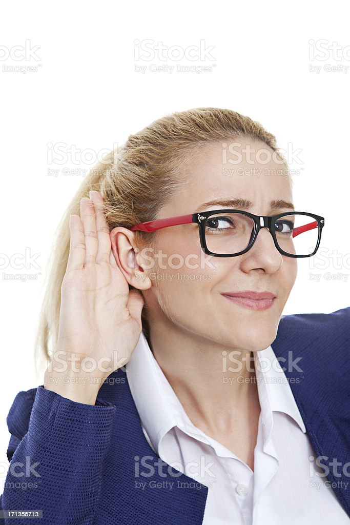 Woman with hand to ear listening royalty-free stock photo