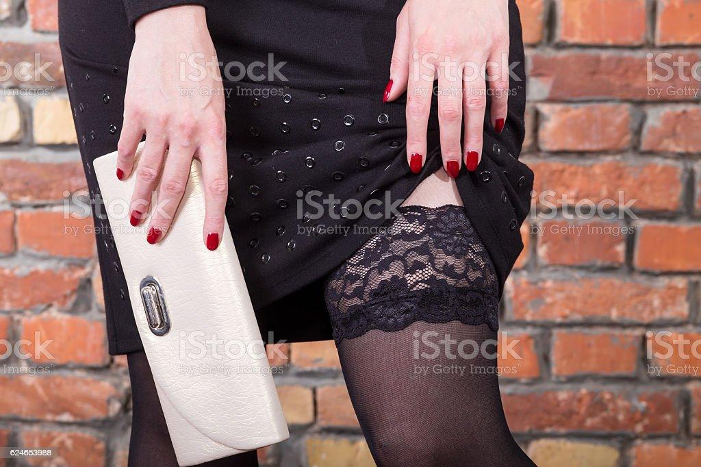 Woman with handbag in stockings stock photo