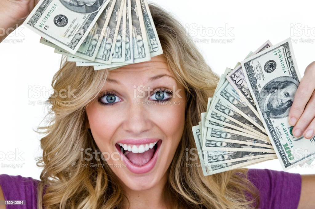 Woman with handfuls of cash royalty-free stock photo