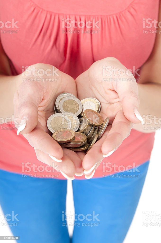 woman with hands full of coins stock photo