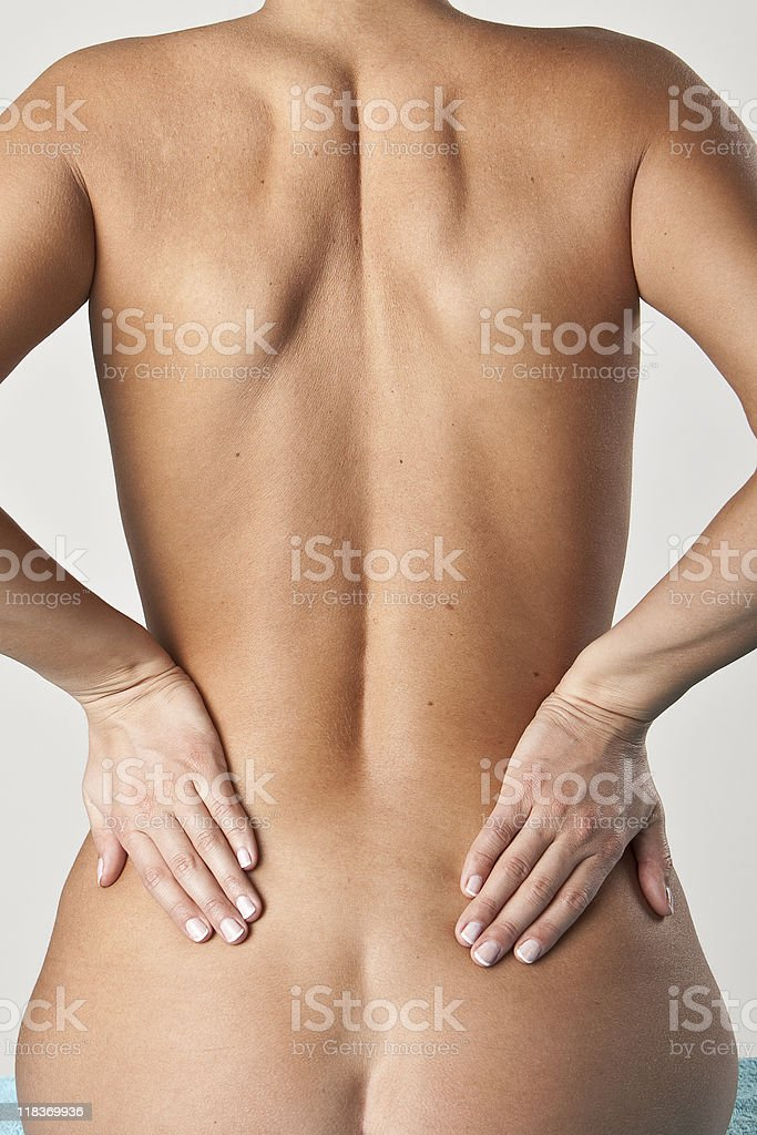 Woman with Hands on Back royalty-free stock photo