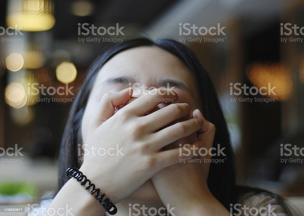woman with hands on face stock photo