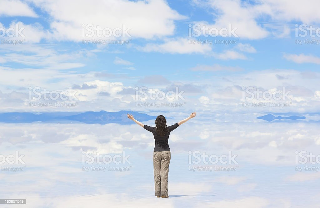 Woman with hands raised royalty-free stock photo