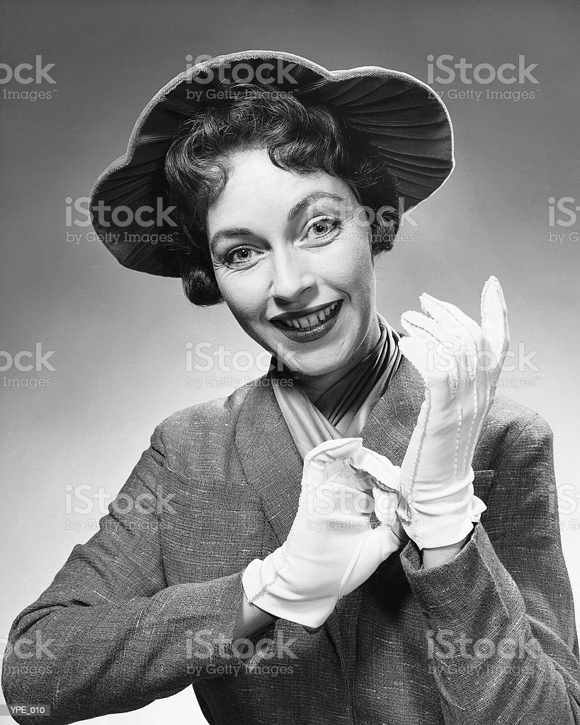 Woman with hat and gloves stock photo