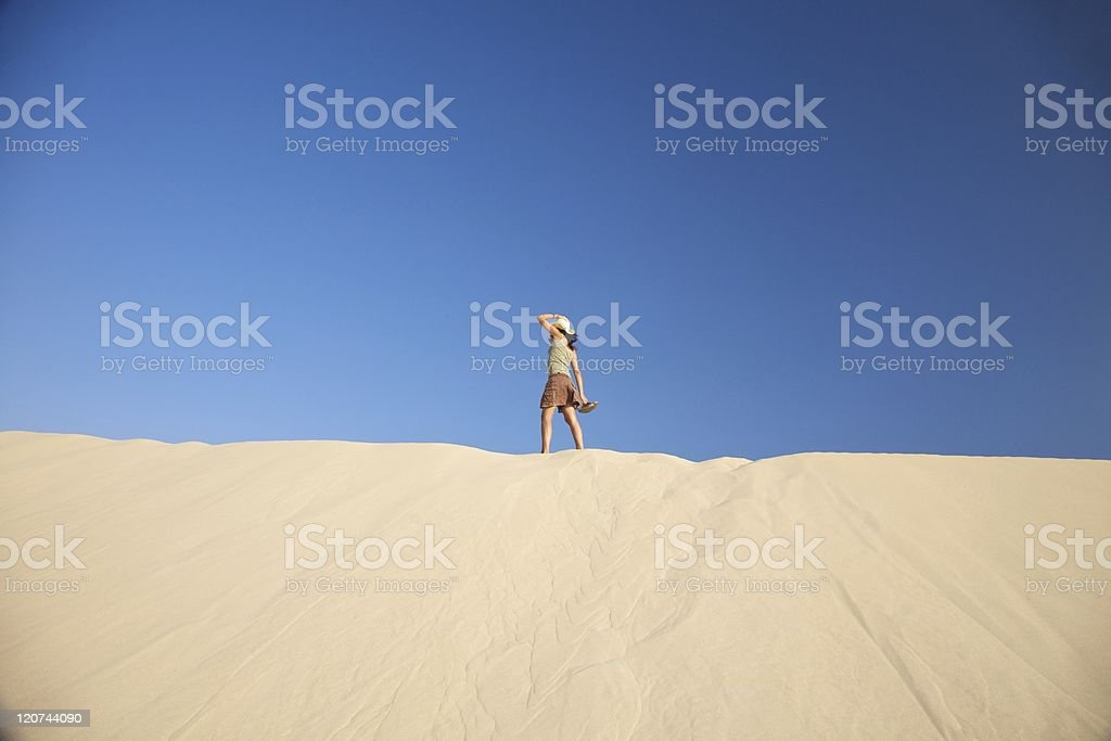 woman with hat on dune royalty-free stock photo