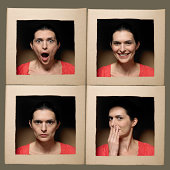 Woman with head in boxes pulling faces