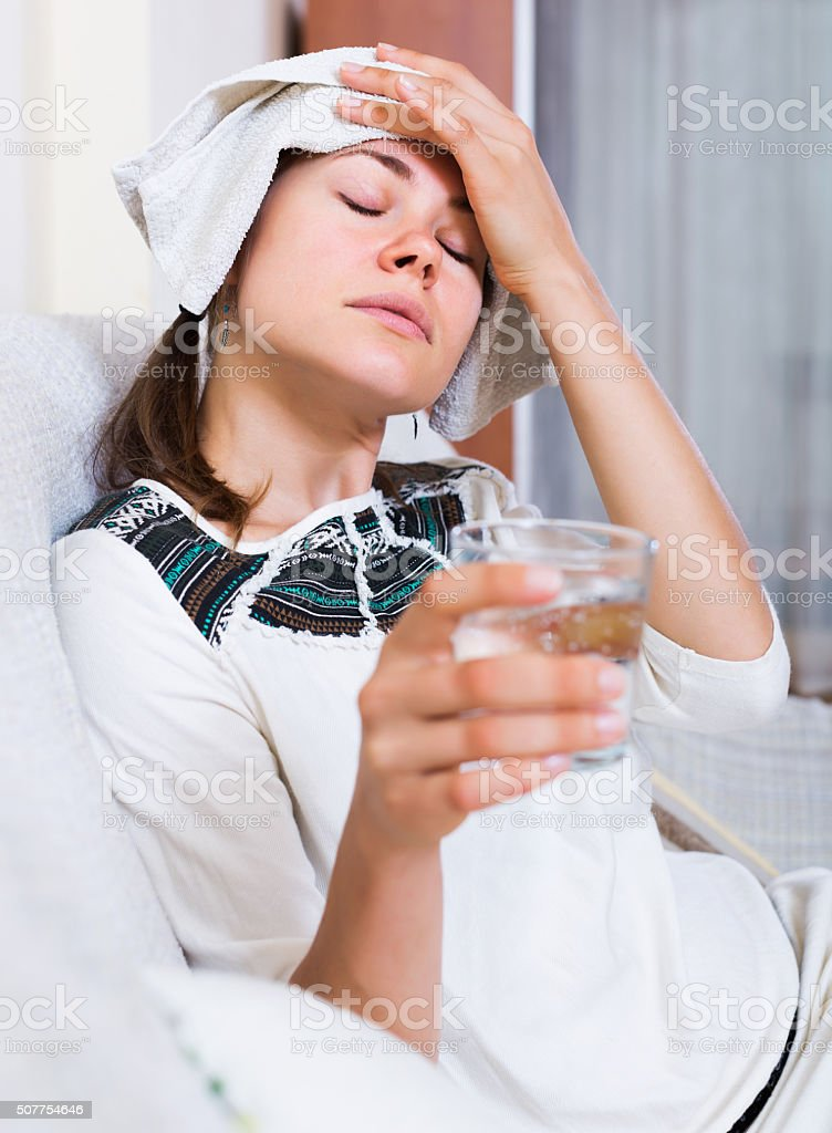 Woman with headache at home stock photo