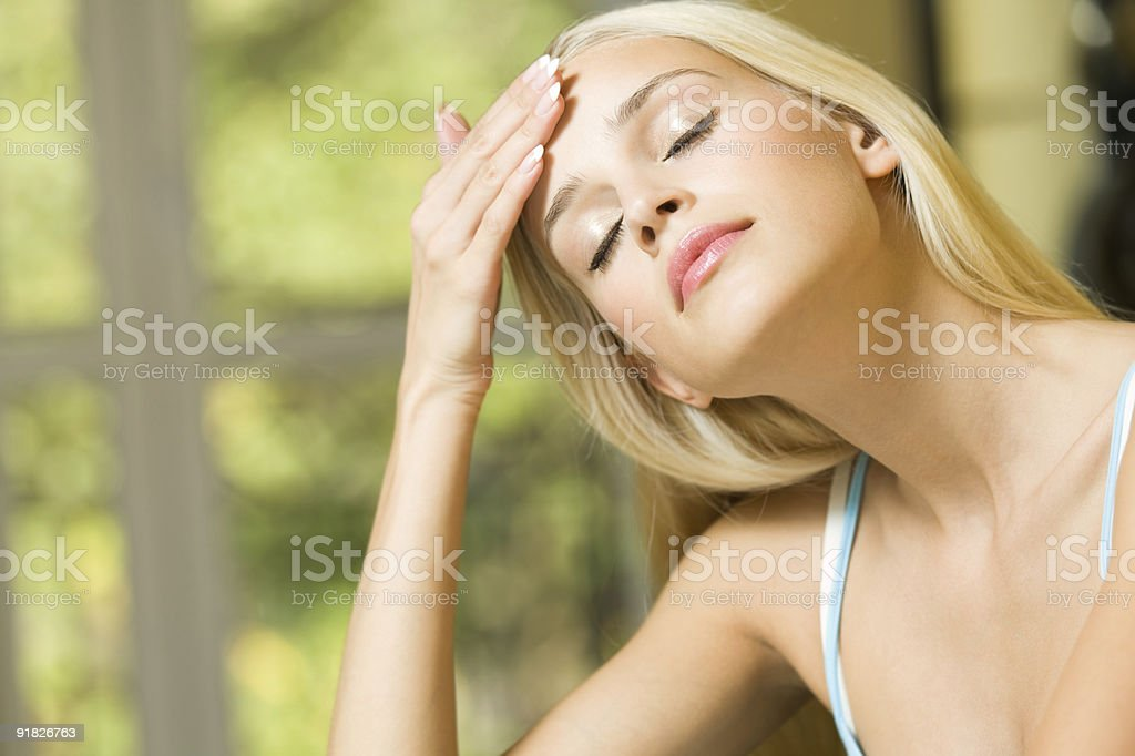 Woman with headache or applying cream on face royalty-free stock photo