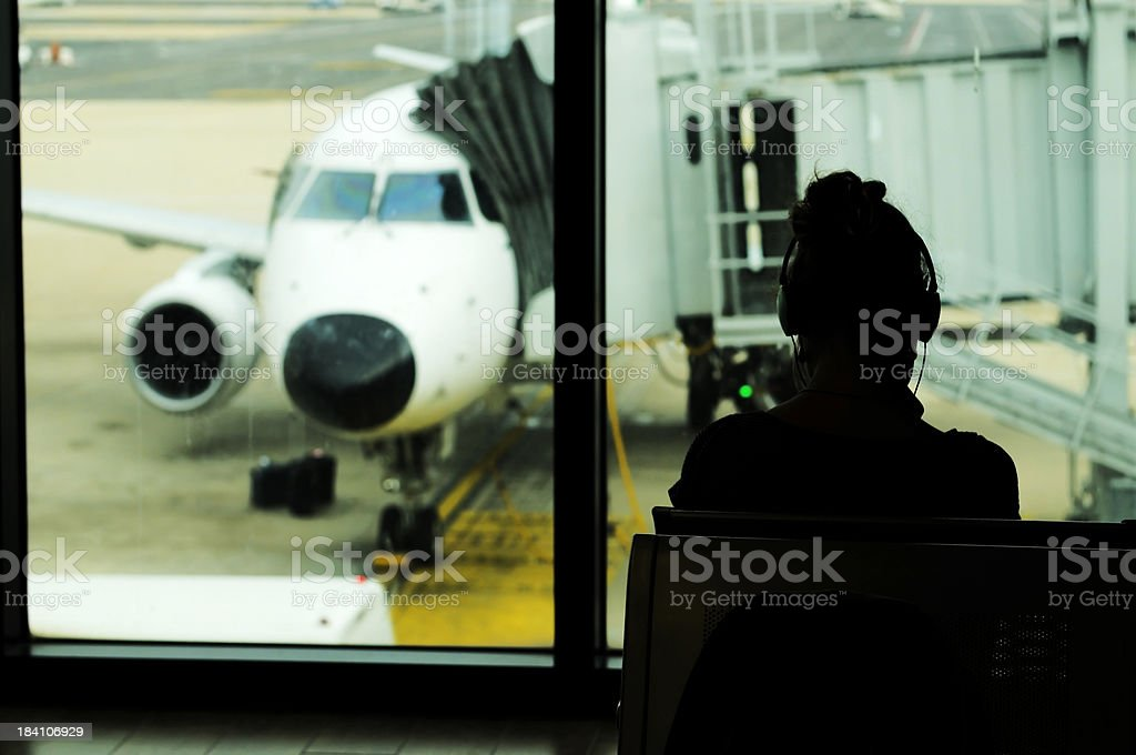 Woman with Headphone Waiting in Airport Lounge royalty-free stock photo