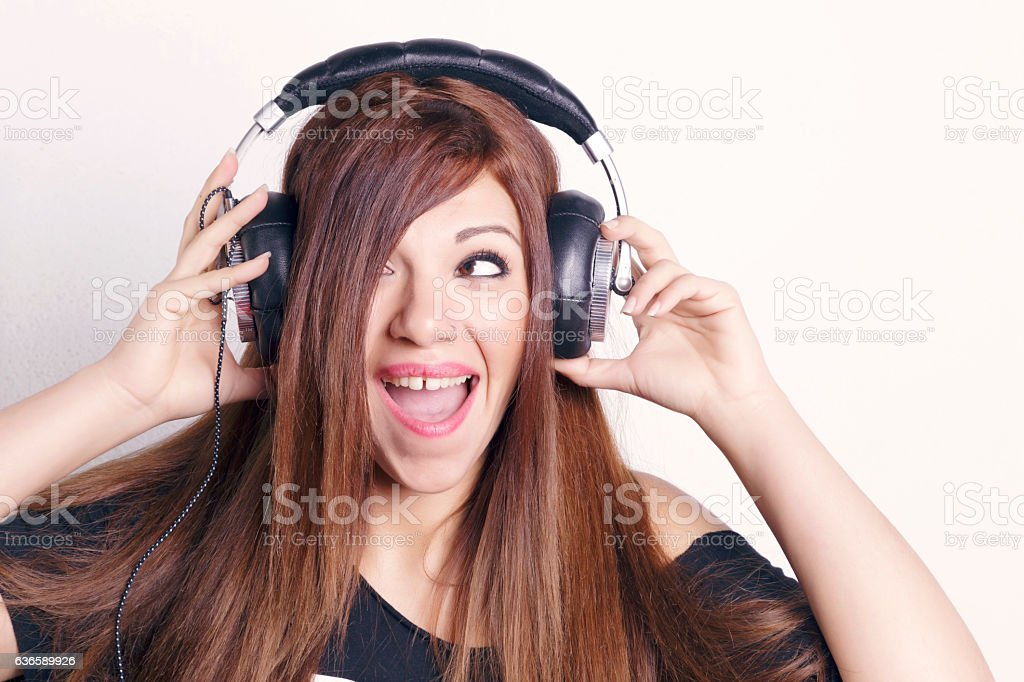 Woman with headphones having fun. stock photo