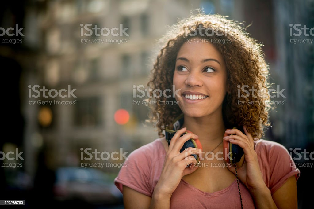 Woman with headphones in the city stock photo
