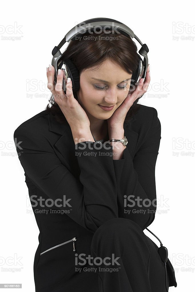 Woman with headphones, listening to music royalty-free stock photo