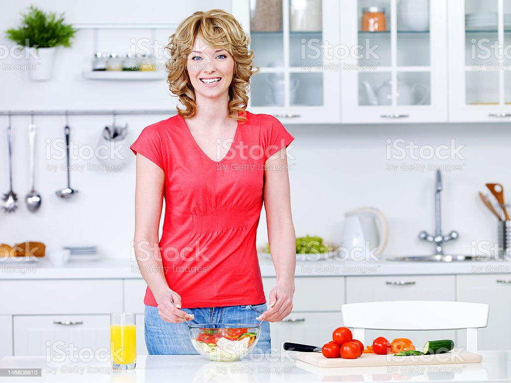 Woman with healthy food in the kitchen royalty-free stock photo