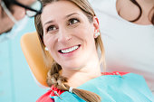 Woman with healthy smile at dentist