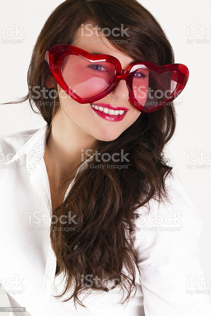 Woman with heart shaped glasses royalty-free stock photo