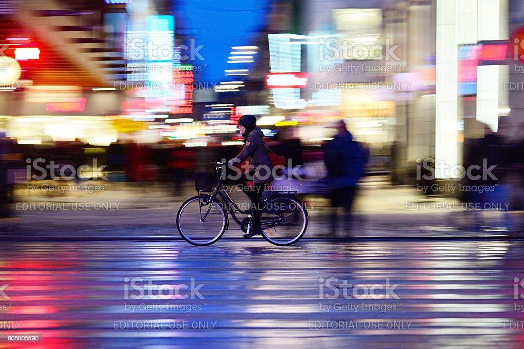 Woman with helmet, biking in night Stockholm stock photo