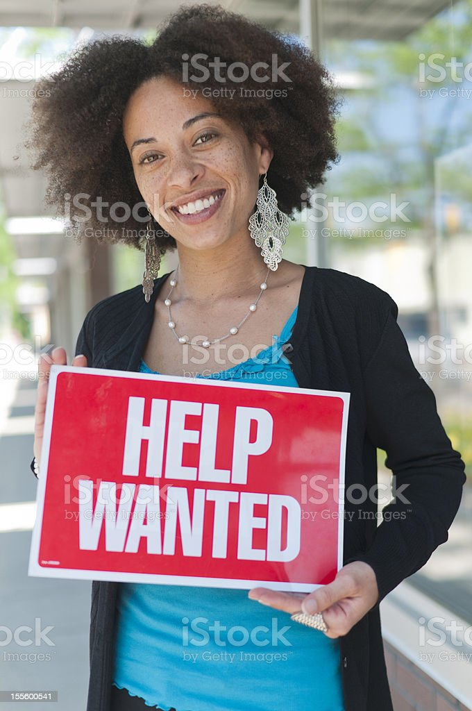 Woman with Help Wanted Sign royalty-free stock photo