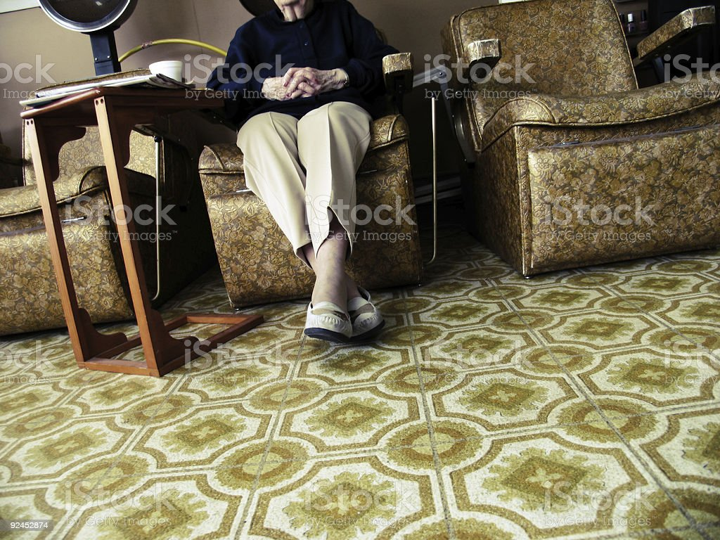 Woman with her Arms and Legs Crossed royalty-free stock photo