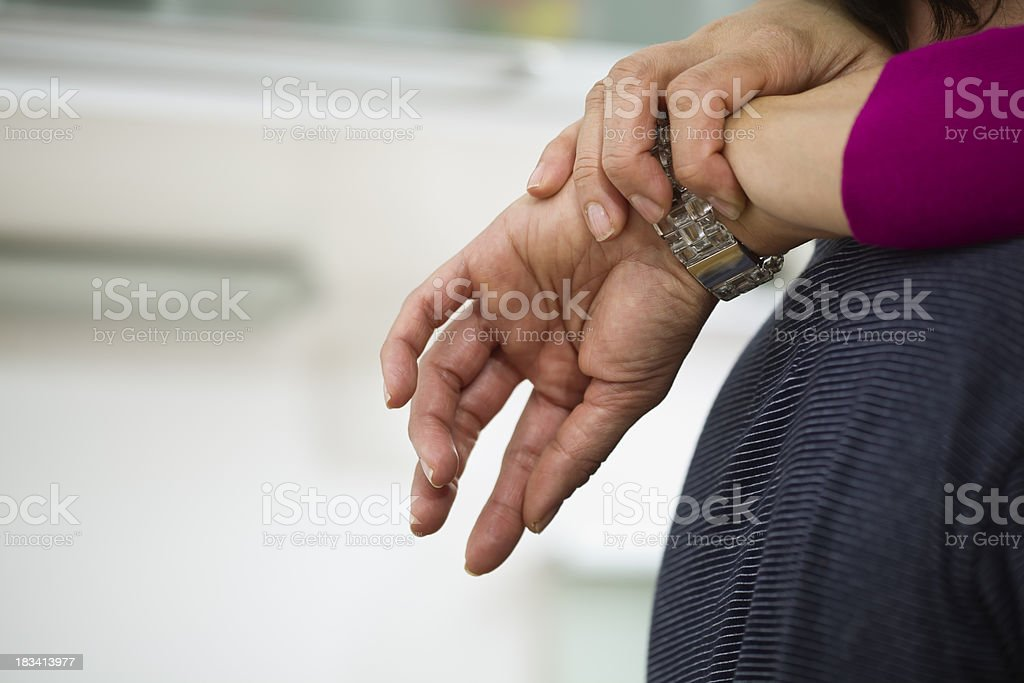 Woman With Her Arms Around a Man stock photo