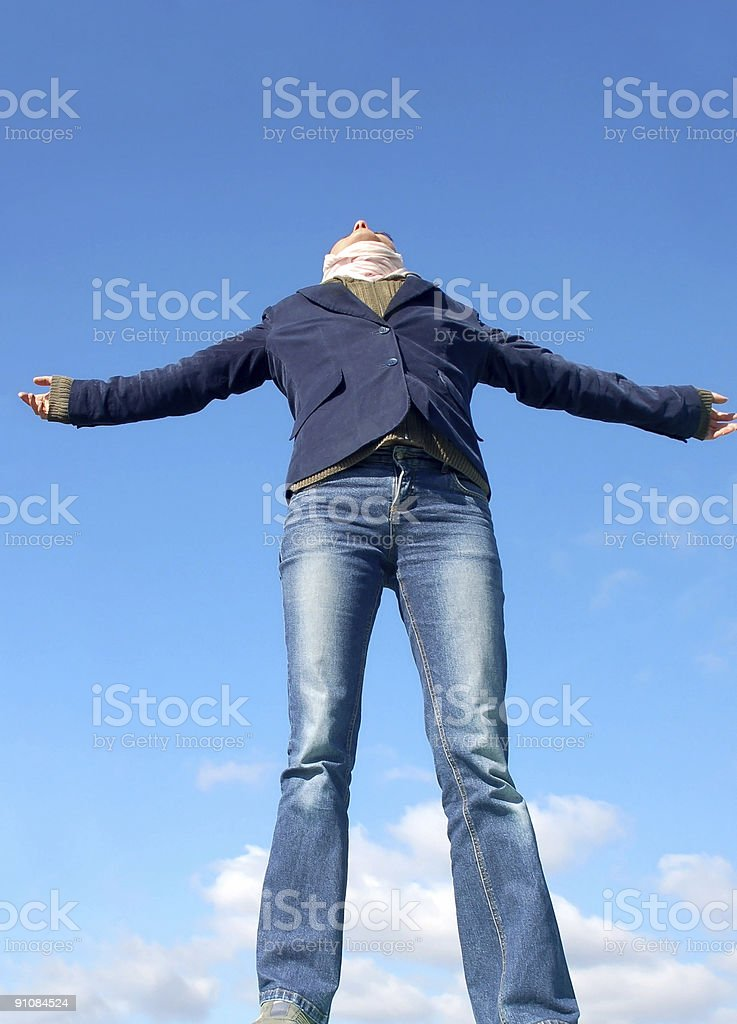Woman with her arms wide open stock photo