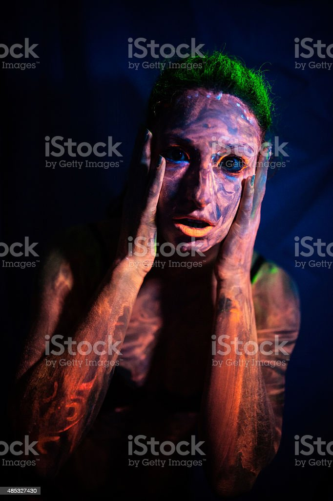 Woman With Her Body Covered With Paint stock photo