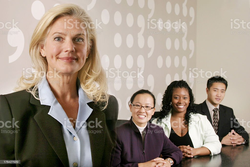 Woman with her business team royalty-free stock photo