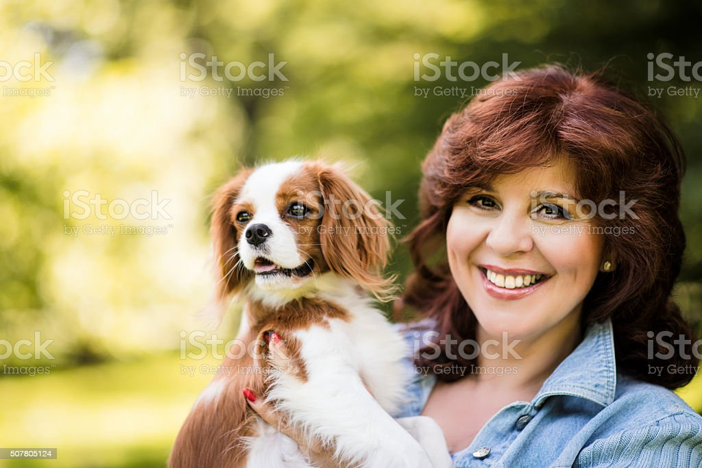 Woman with her dog in nature stock photo