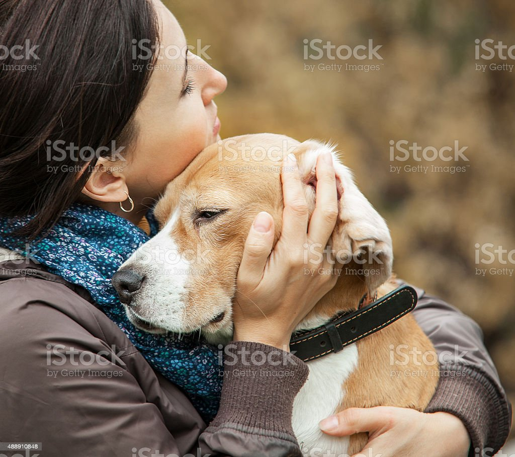 Woman with her dog tender hugs stock photo