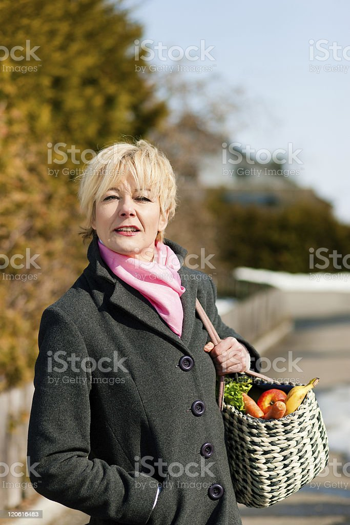 Woman with her groceries royalty-free stock photo