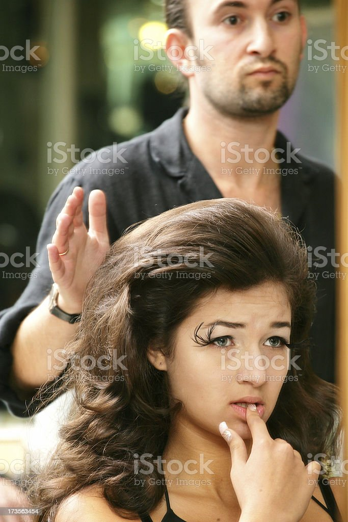 Woman with her hair stylist royalty-free stock photo