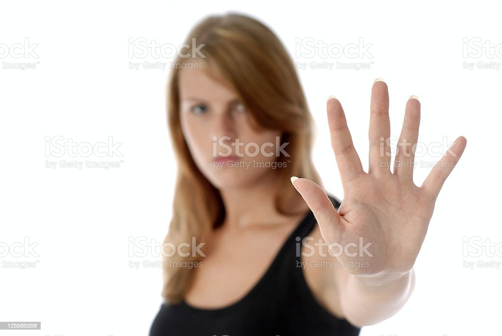 A woman with her hand up symbolizing No royalty-free stock photo