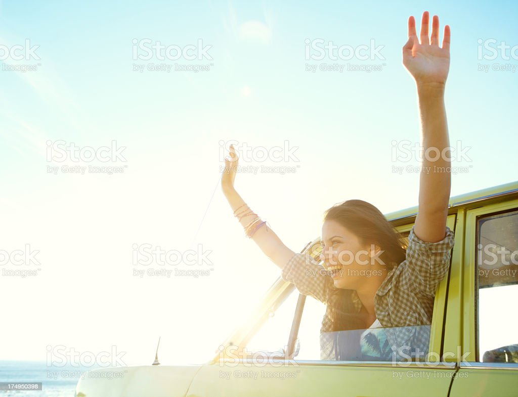 Woman with her hands out a car window enjoying the air royalty-free stock photo