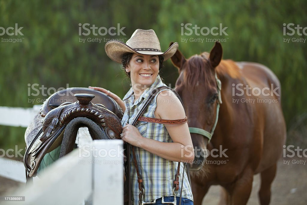 Woman With Her Horse on a Ranch royalty-free stock photo