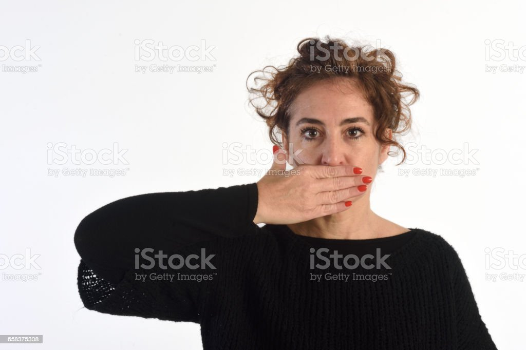 A woman with her mouth covered stock photo